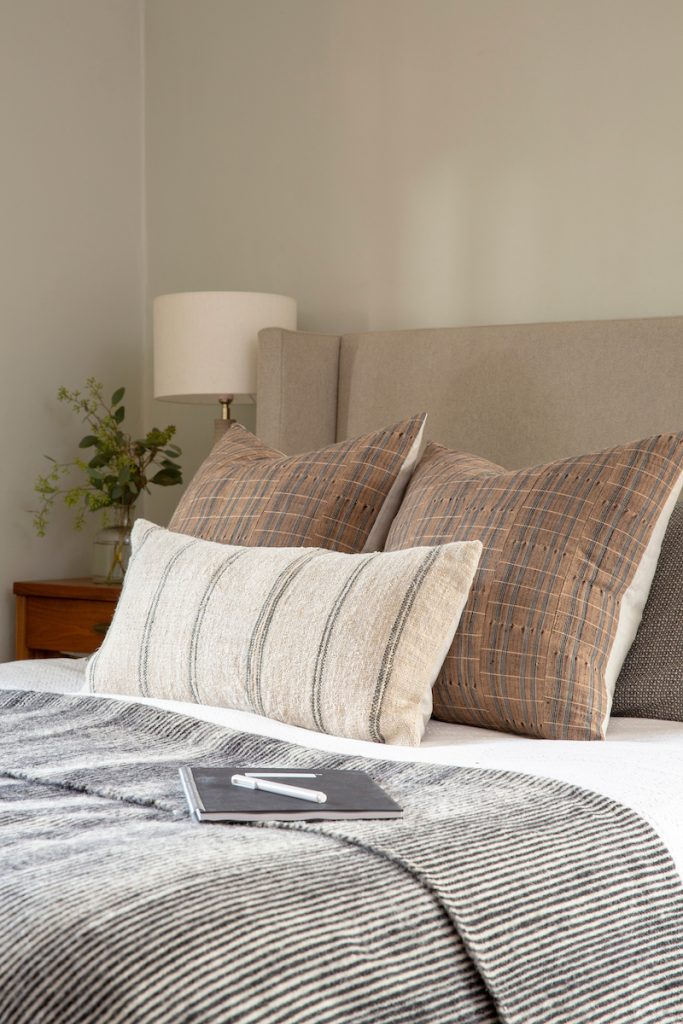 Play around with layering pillows and blankets you already own to achieve a similar look.