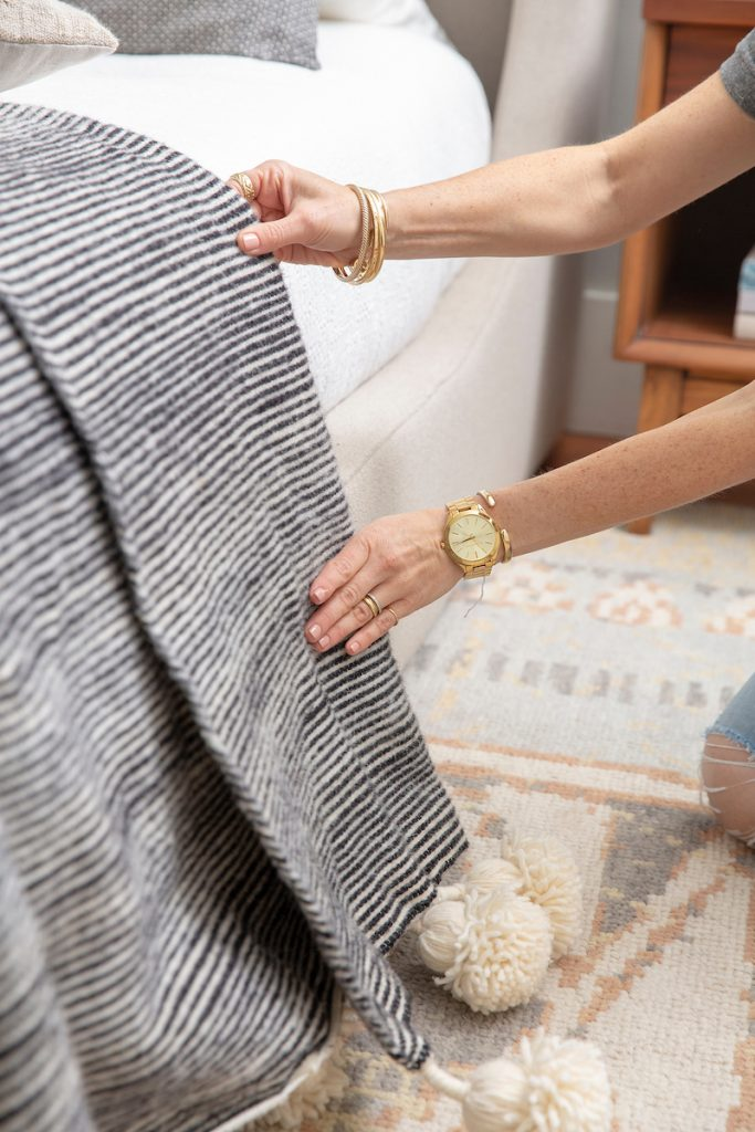 Adding an oversized throw blanket makes your bed look cozy and inviting.